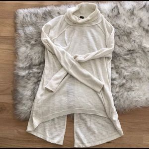 Free People Turtleneck sweater with split back.